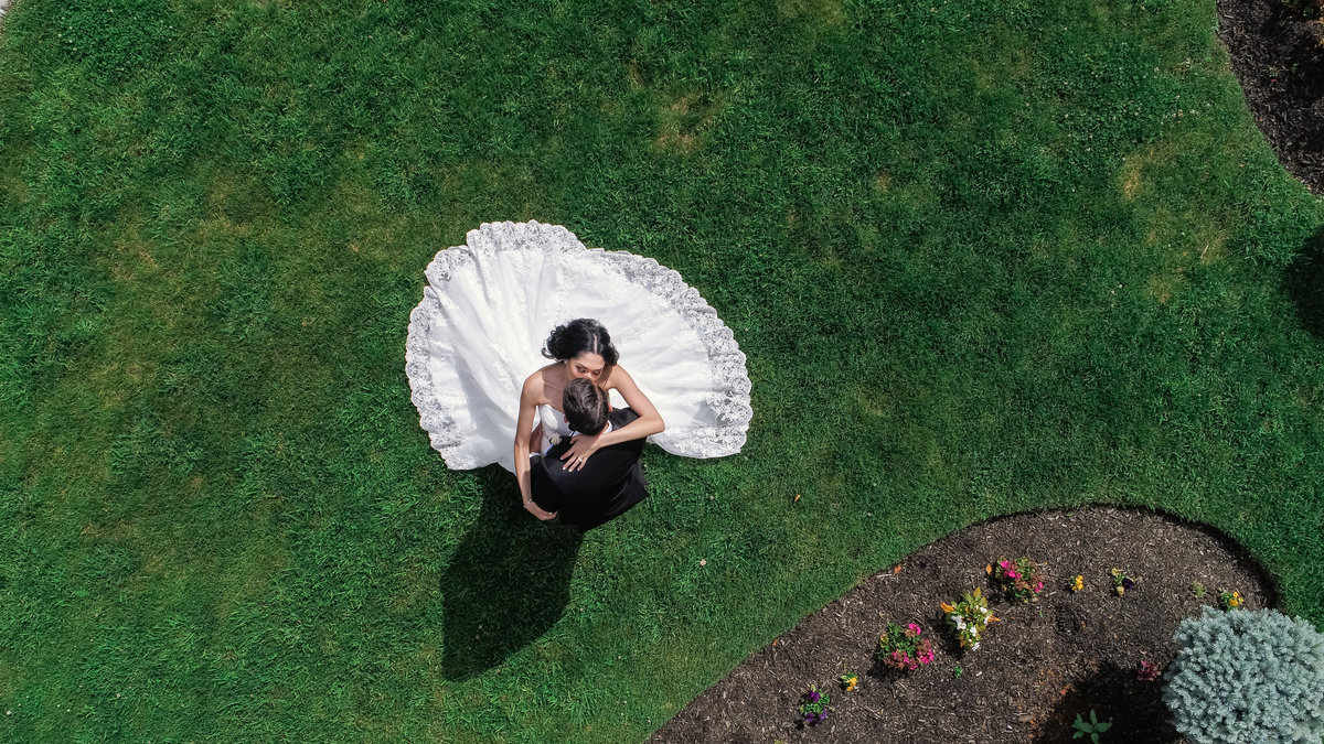 Drone photo of bride and groom at Glen Cove Mansion