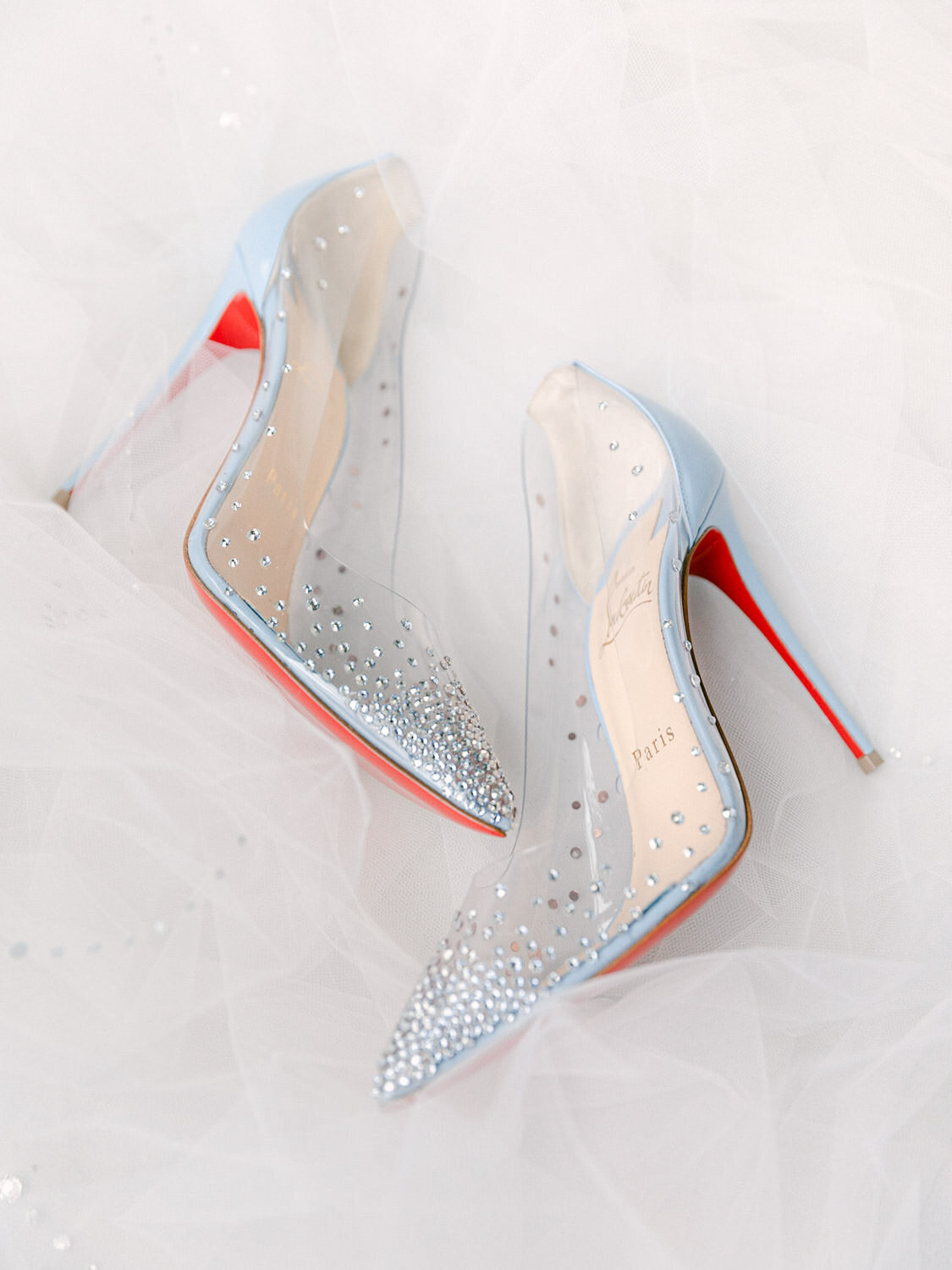 light blue Louboutin high heel shoes with red bottom and  shimmer top