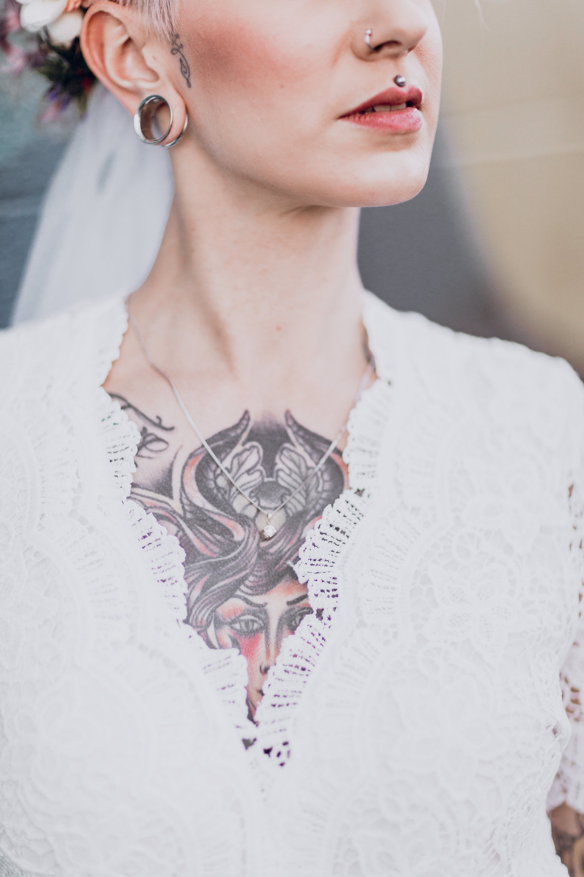 Downtown Reno elopement pictures close-up of bride's detailed dress and tattoos