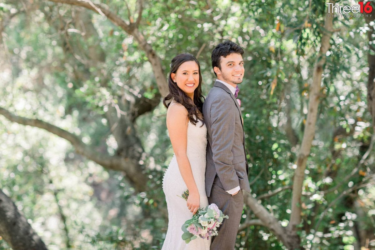 Bride and Groom pose together during their photo shoot