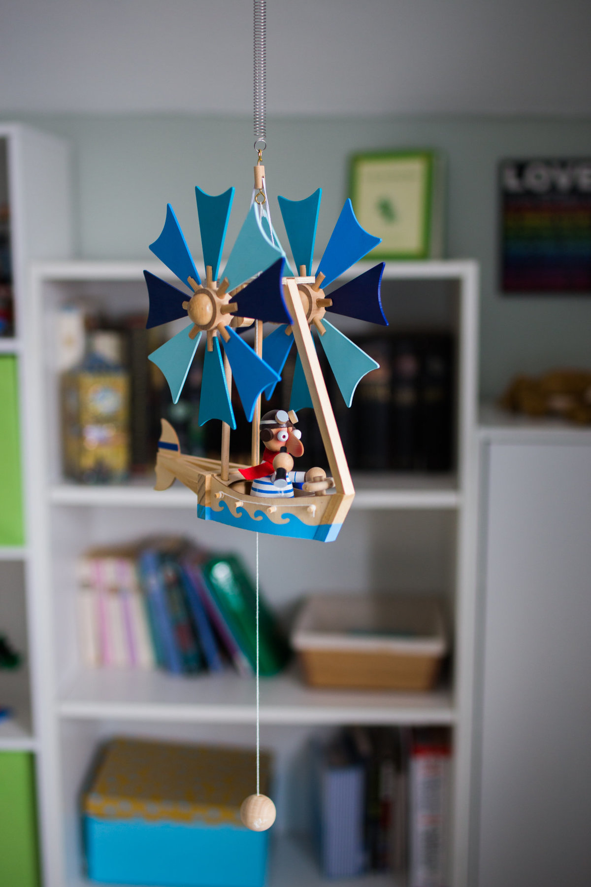 Toy hanging from nursery ceiling at lifestyle newborn session with Jennifer Blaak Photography