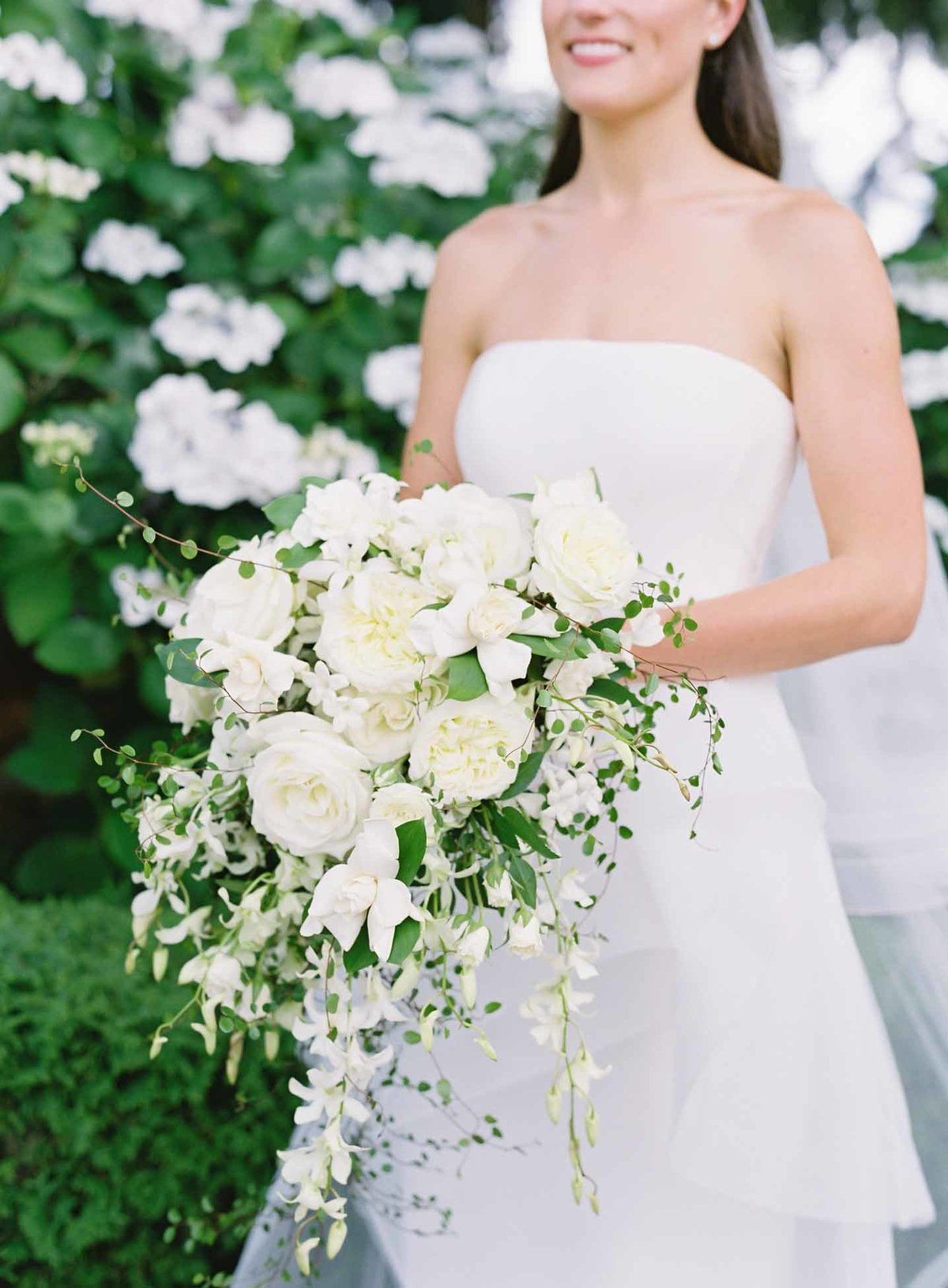 Beautiful bridal cascade bouquet of garden roses, gardenias, and stephanotis.