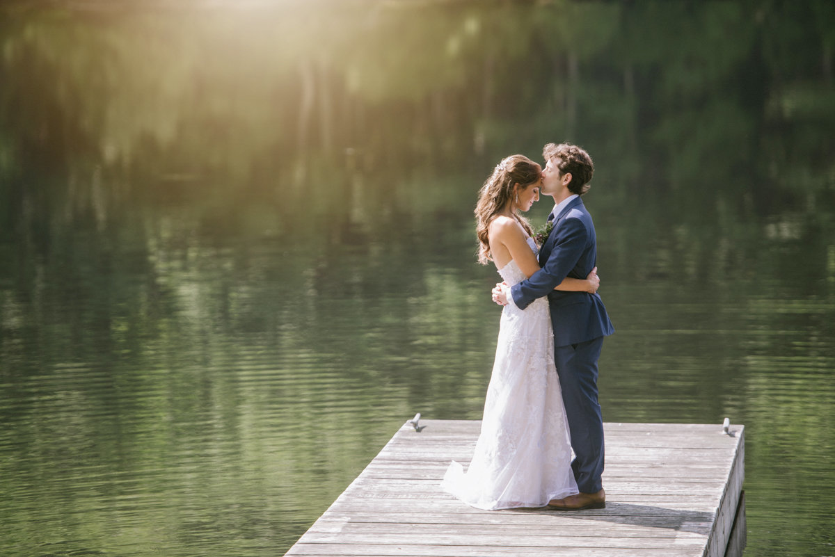summer golden hour lake cedar lakes estate ny upstate new york kiss wedding couple love bright happy woodland