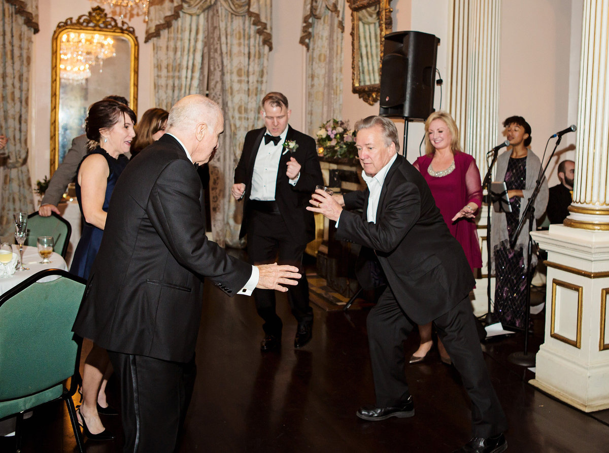 grandpa cutting a rug at wedding reception at The Columns Hotel