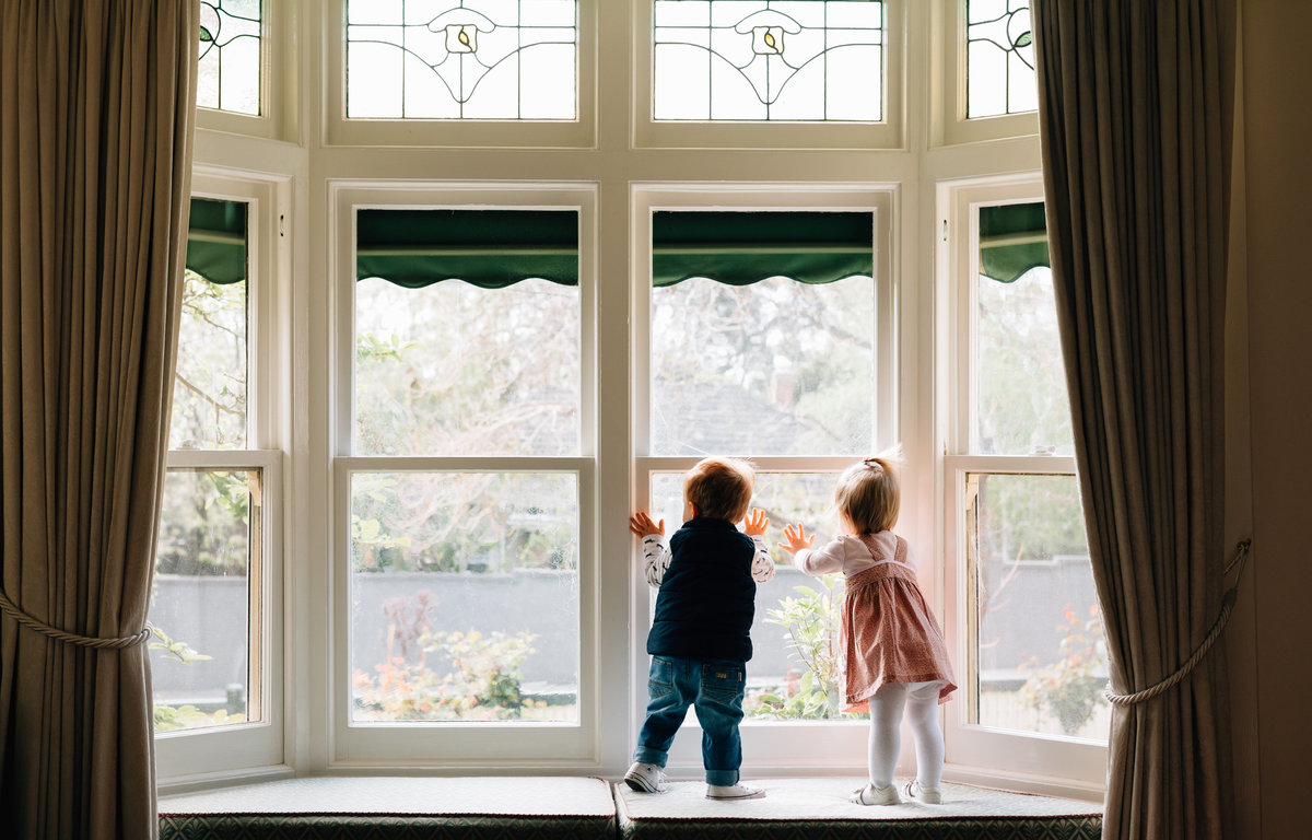 twins in bay window Melbourne lifestyle family photography And So I Don't Forget Photography