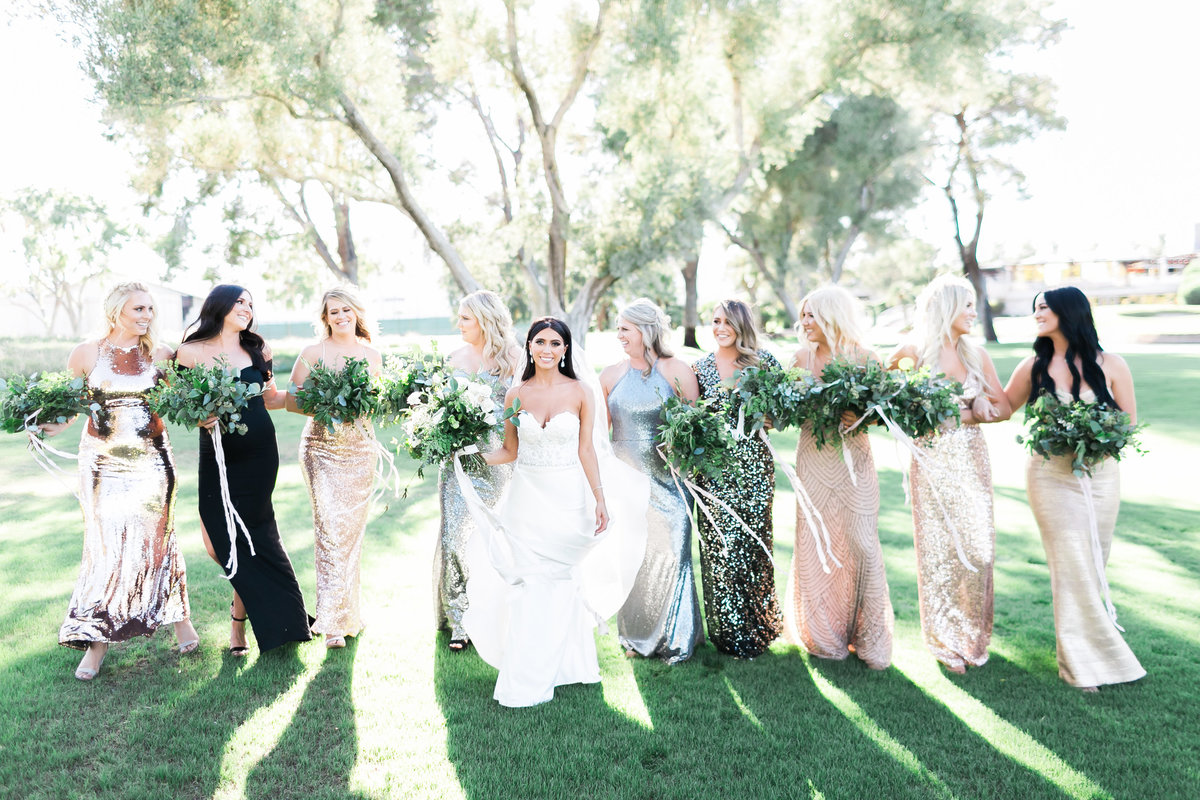las vegas wedding bridesmaid photo with mixed metallic dresses on golf course