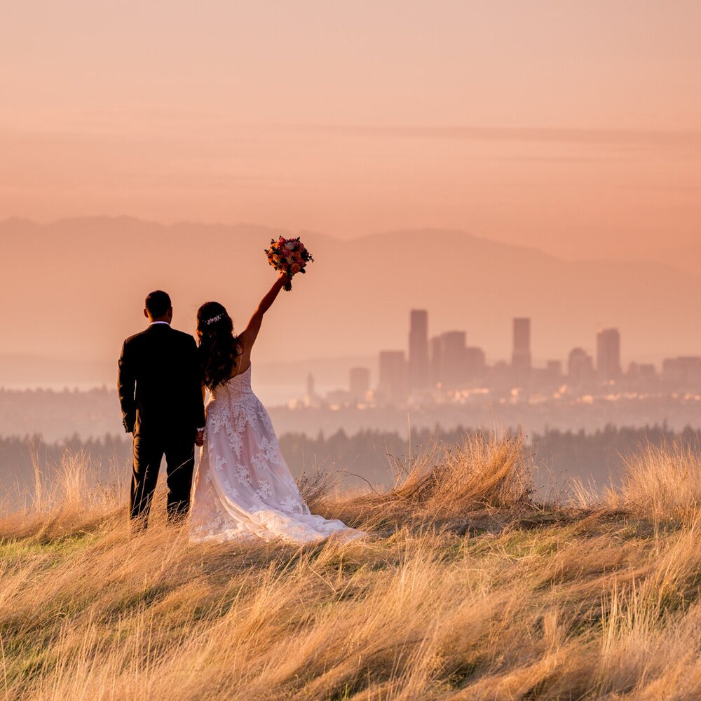 Seattle Wedding Photographer and Videographer Bride and Groom at Newcastle Golf Club with Seattle Skyline Wedding Photo