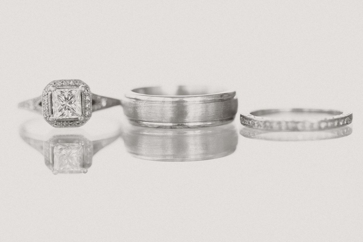 Engagment ring, and two wedding bands lined up at D'amore Indianapolis