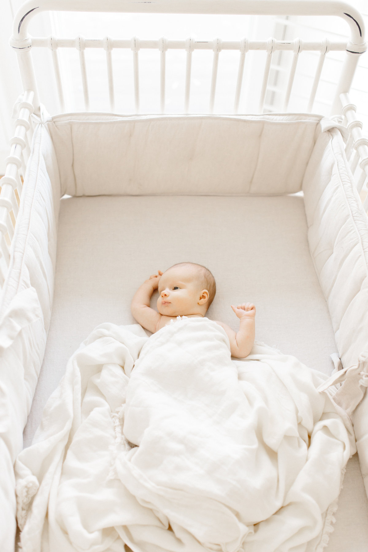 Baby laying in crib