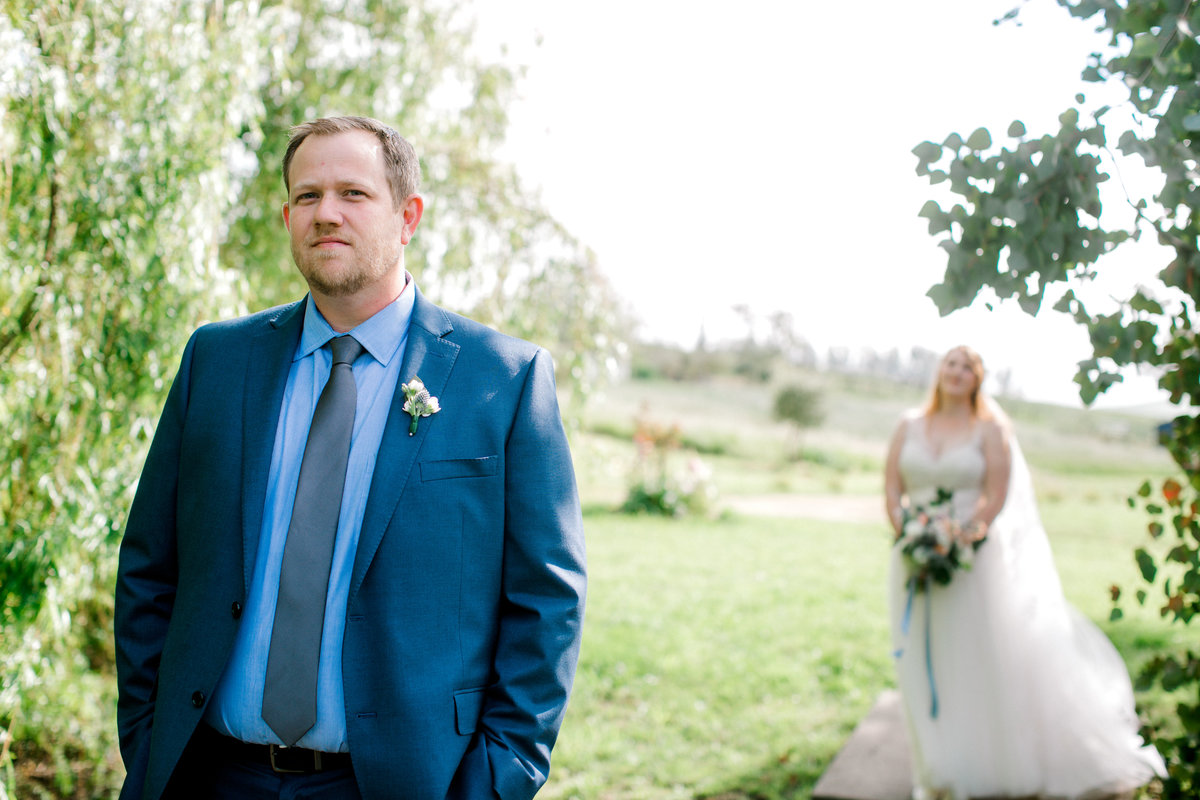 Groom waiting for bride during first look at Olympias Valley Estate in Petaluma California