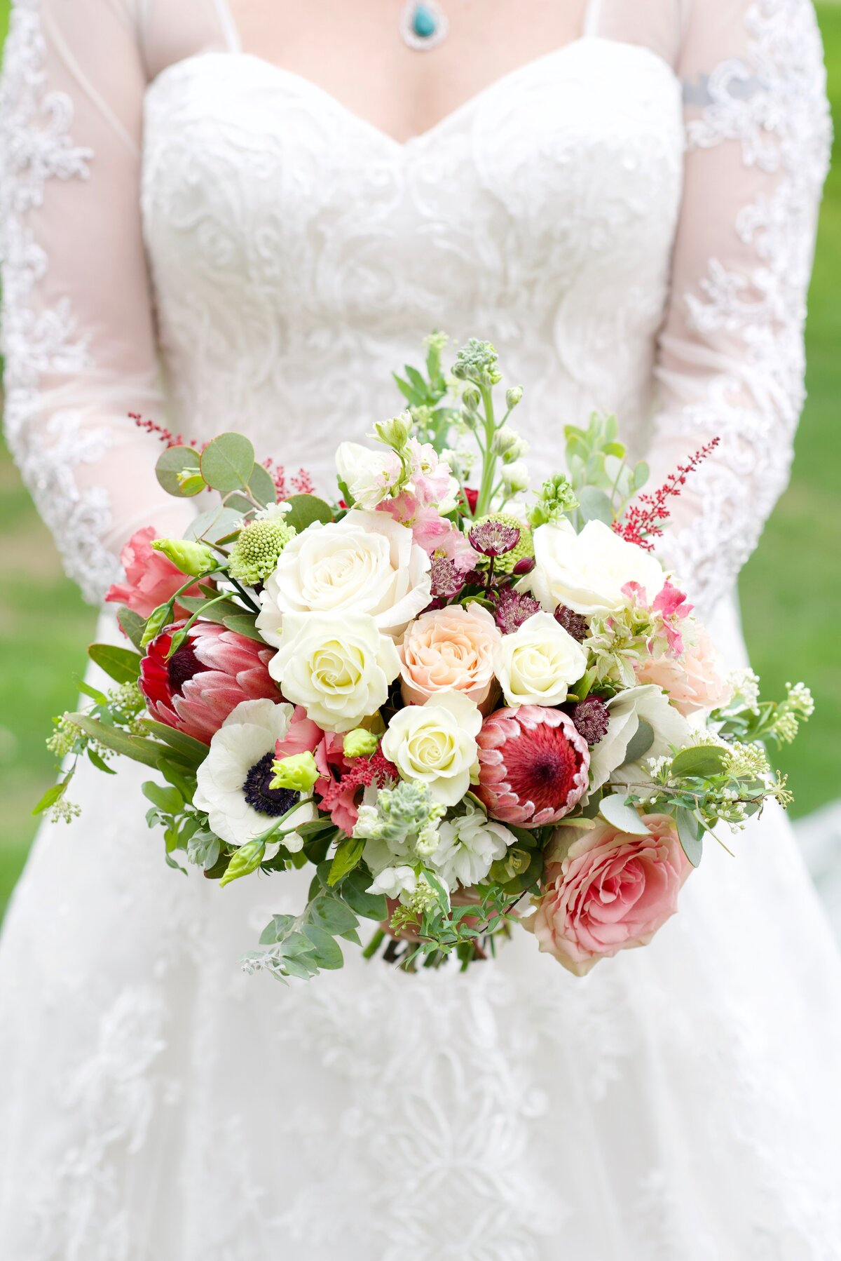 bride with white and pink flowers