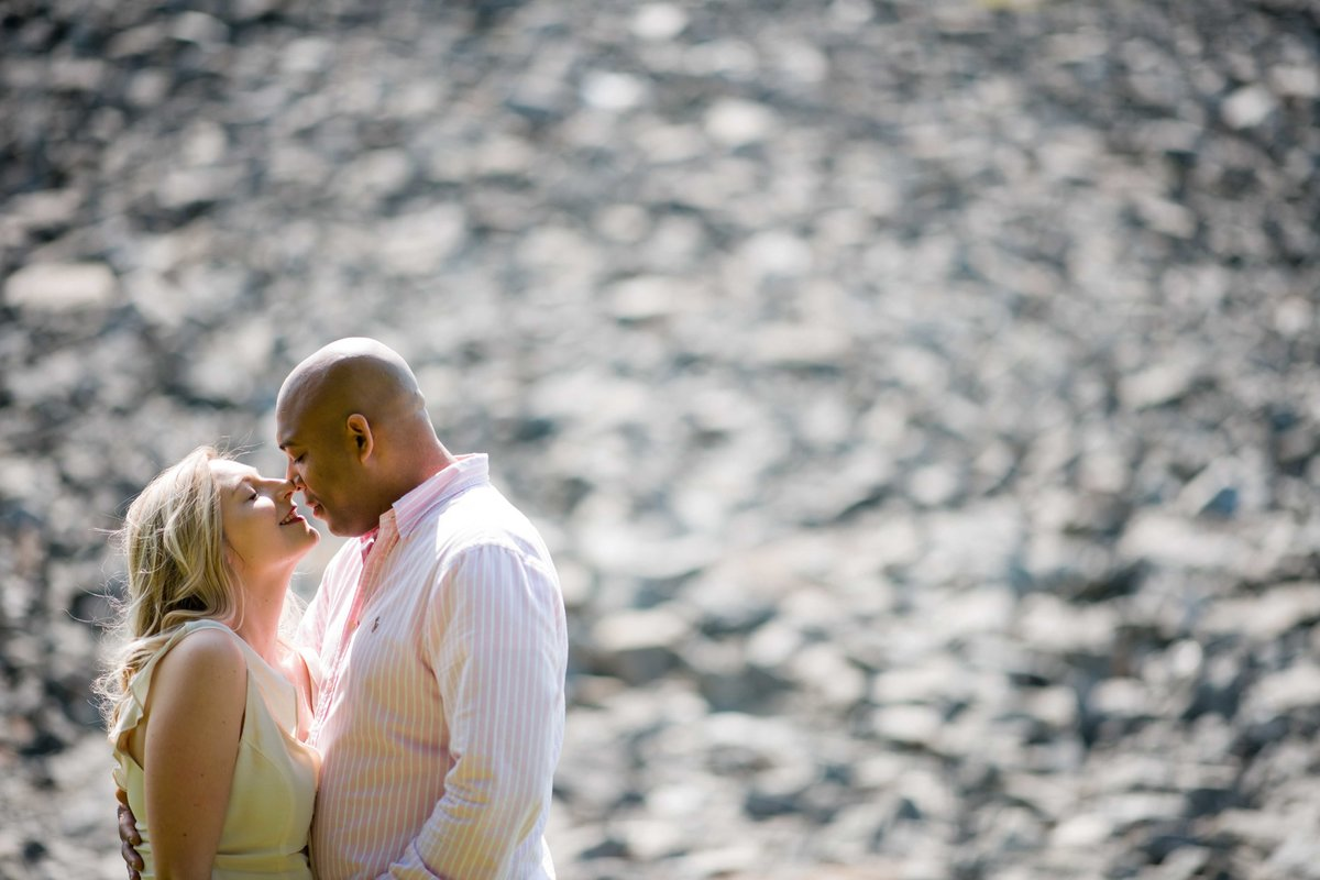 05 engagement photo of interracial couple in front of rocks by ct wedding photographer