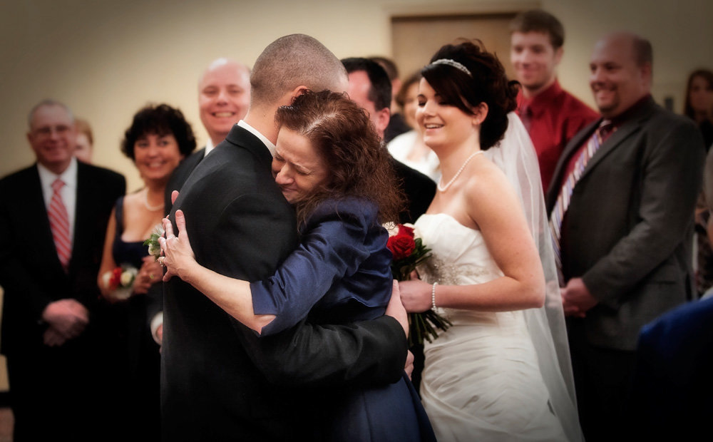 The bride's mom gives her new son-in-law a huge hug during the ceremony at the Doubletree Hotel in Bloomington, Illinois.
