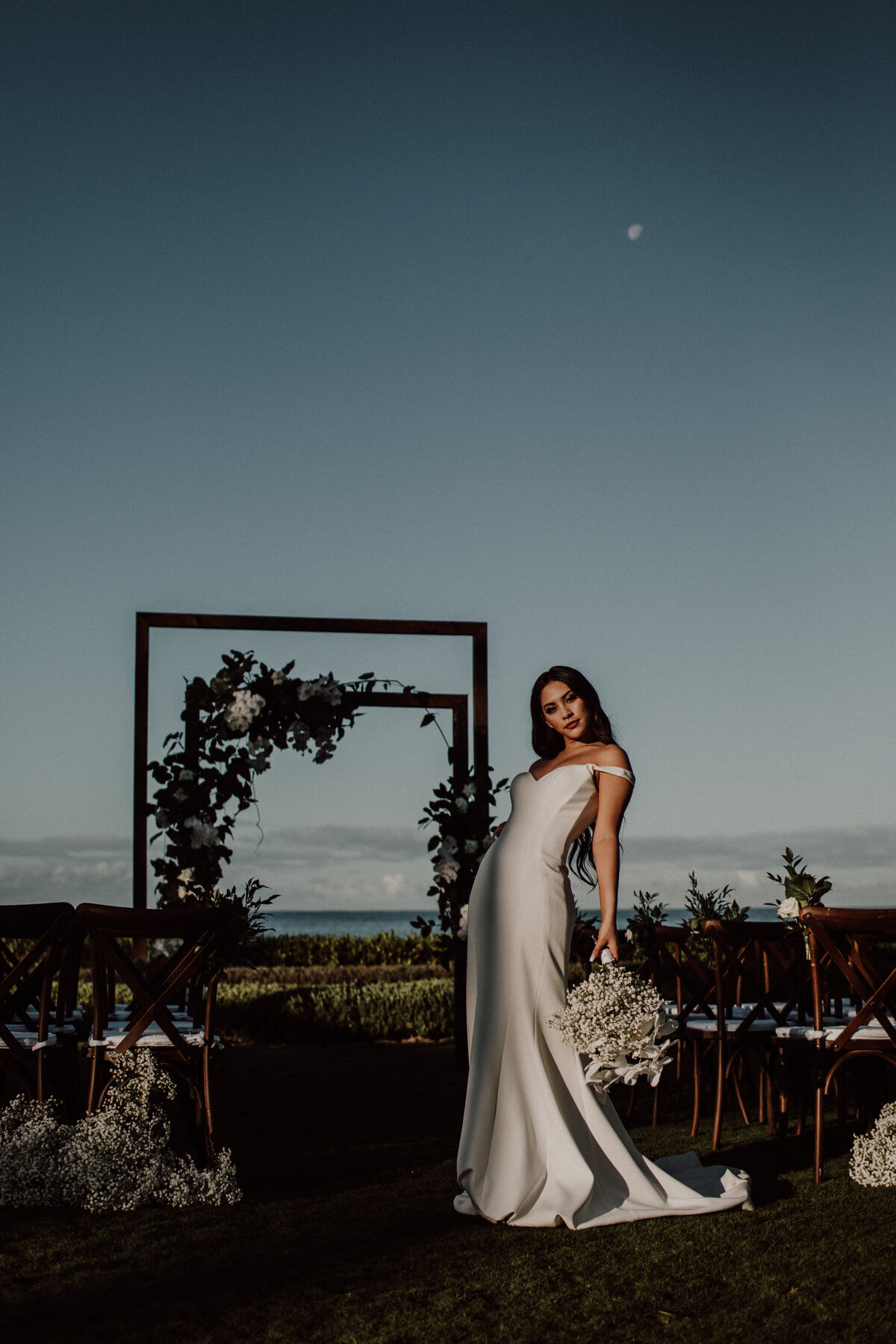 bride-standing-in-front-of-ceremony-site-four-seasons-ko-olina