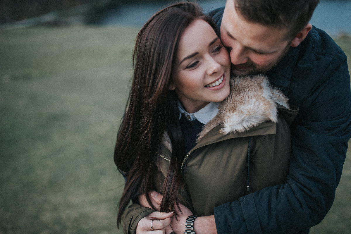 Man hugging his fiance on their pre-wedding shoot