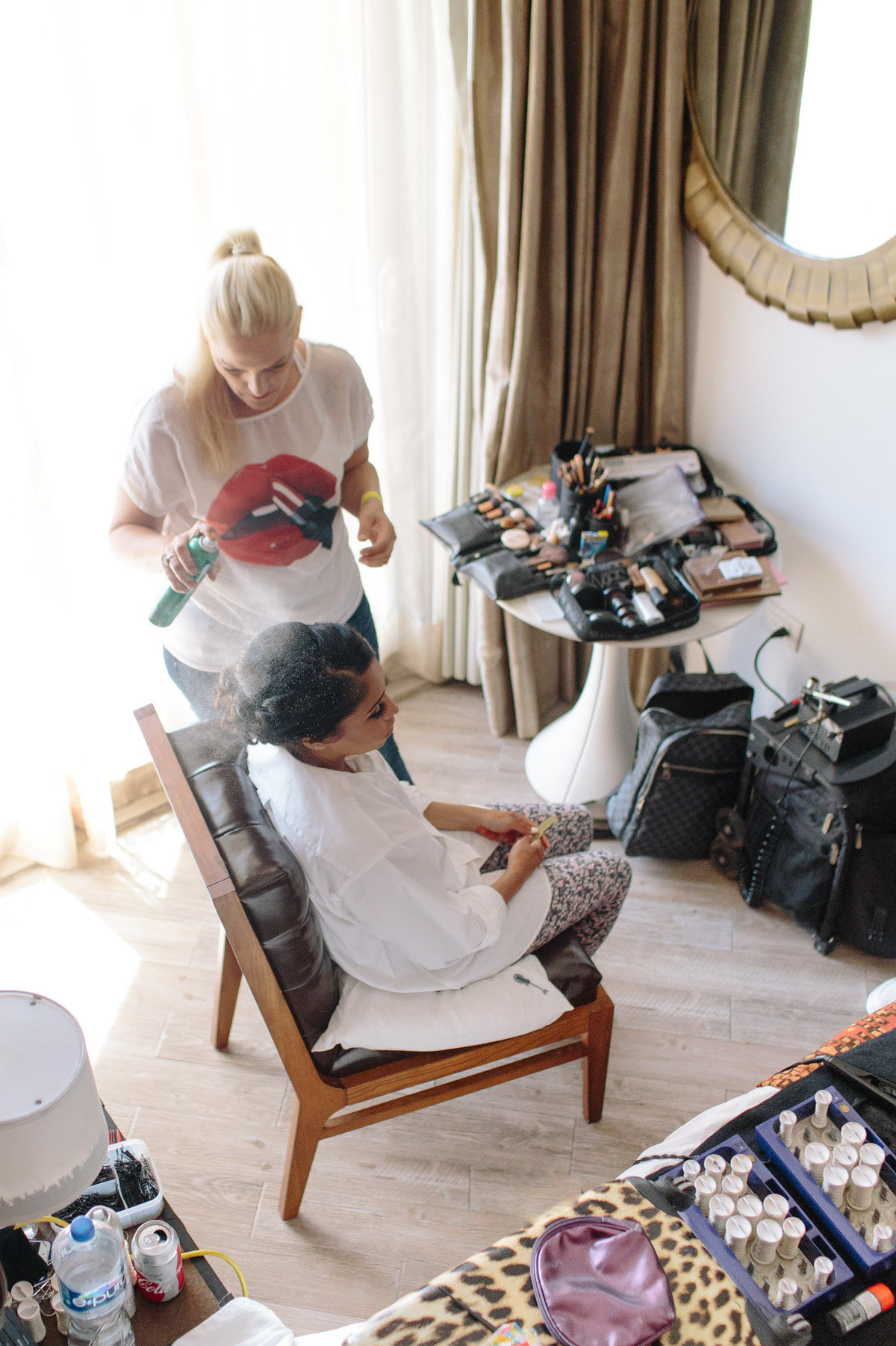 Destination bride getting hair perfected.  Photo by Rebecca Cerasani.