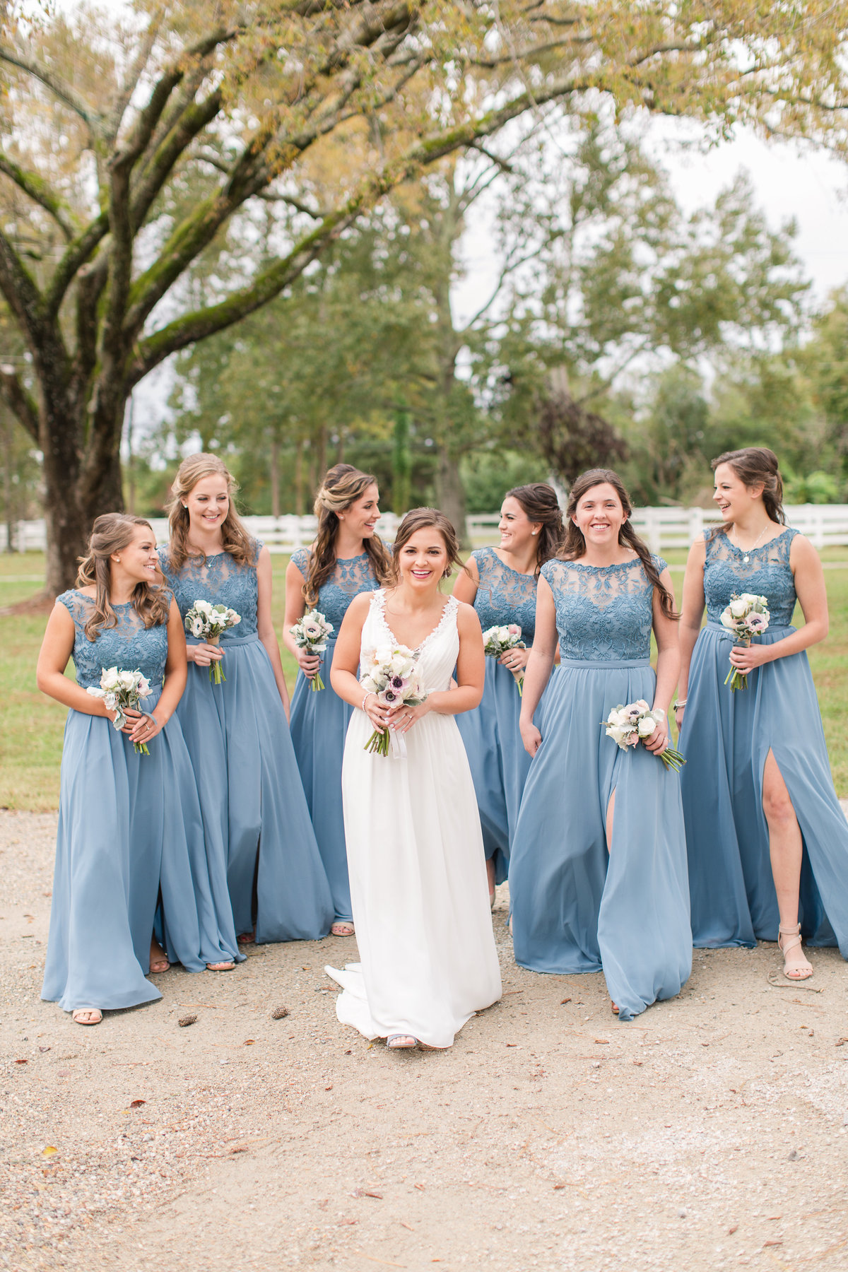 beautiful bridesmaids in dusty blue dresses