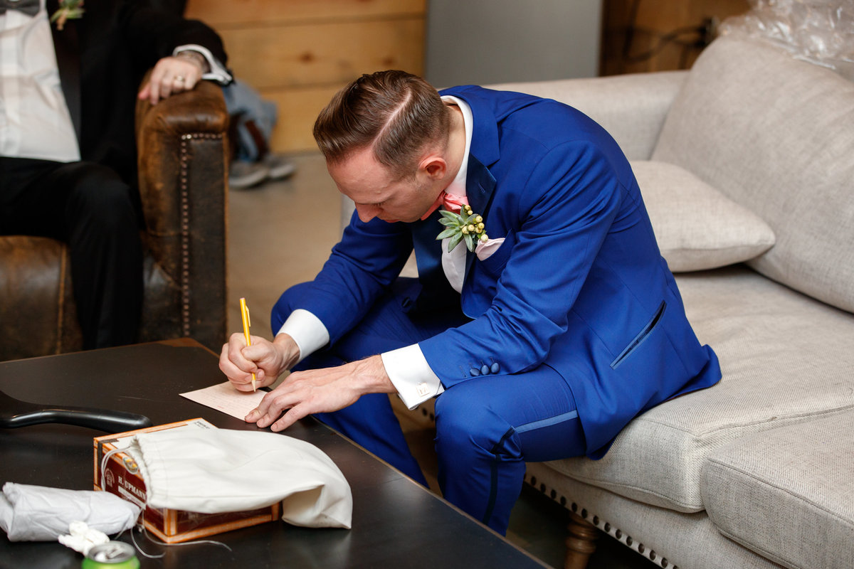 Austin wedding photographer addison grove wedding photographer groom writing letter
