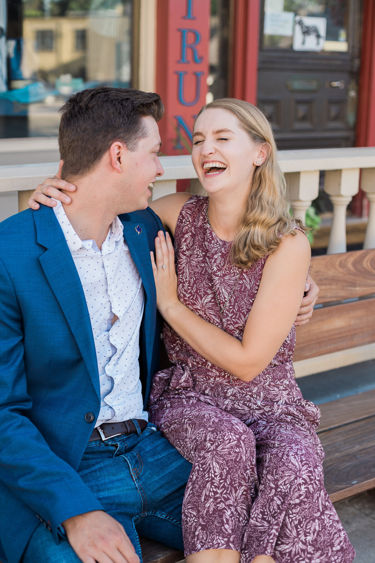 woman laughing at fiancé in engagement photo