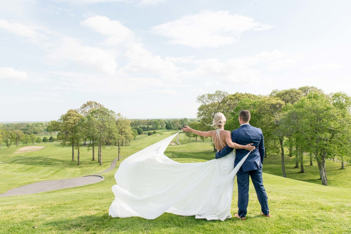 Bride and groom at the golf course of Giorgio's Baiting Hollow