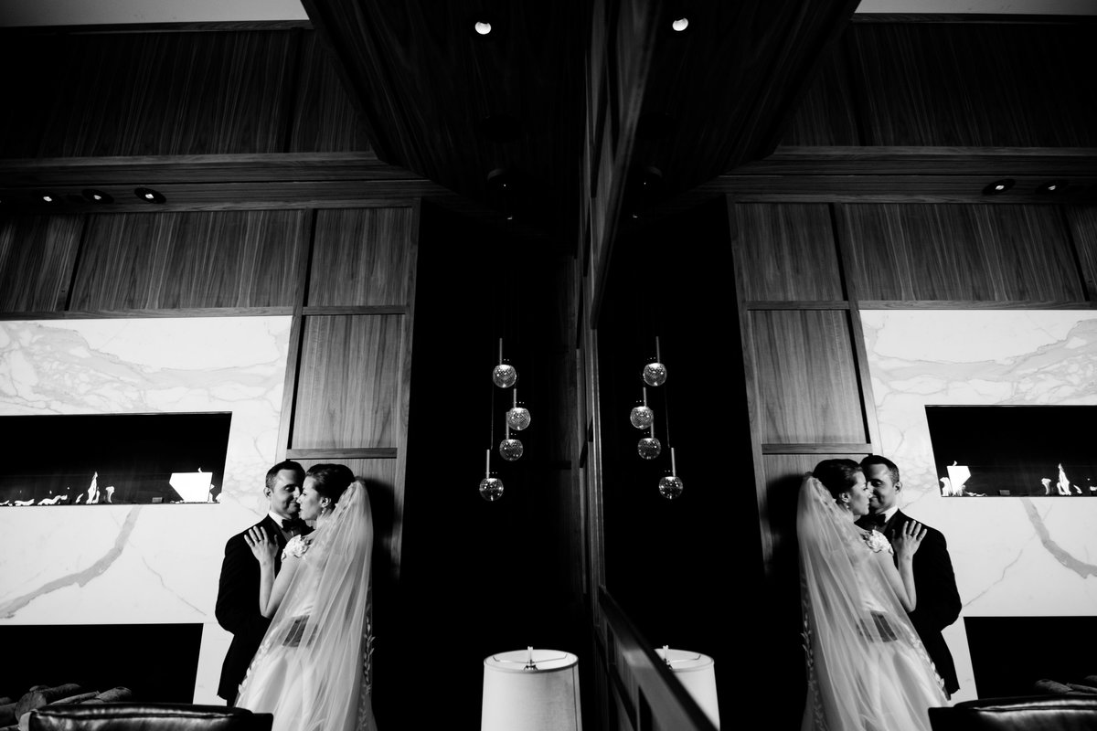 black and white reflection image with bride and groom in Ritz hotel Boston