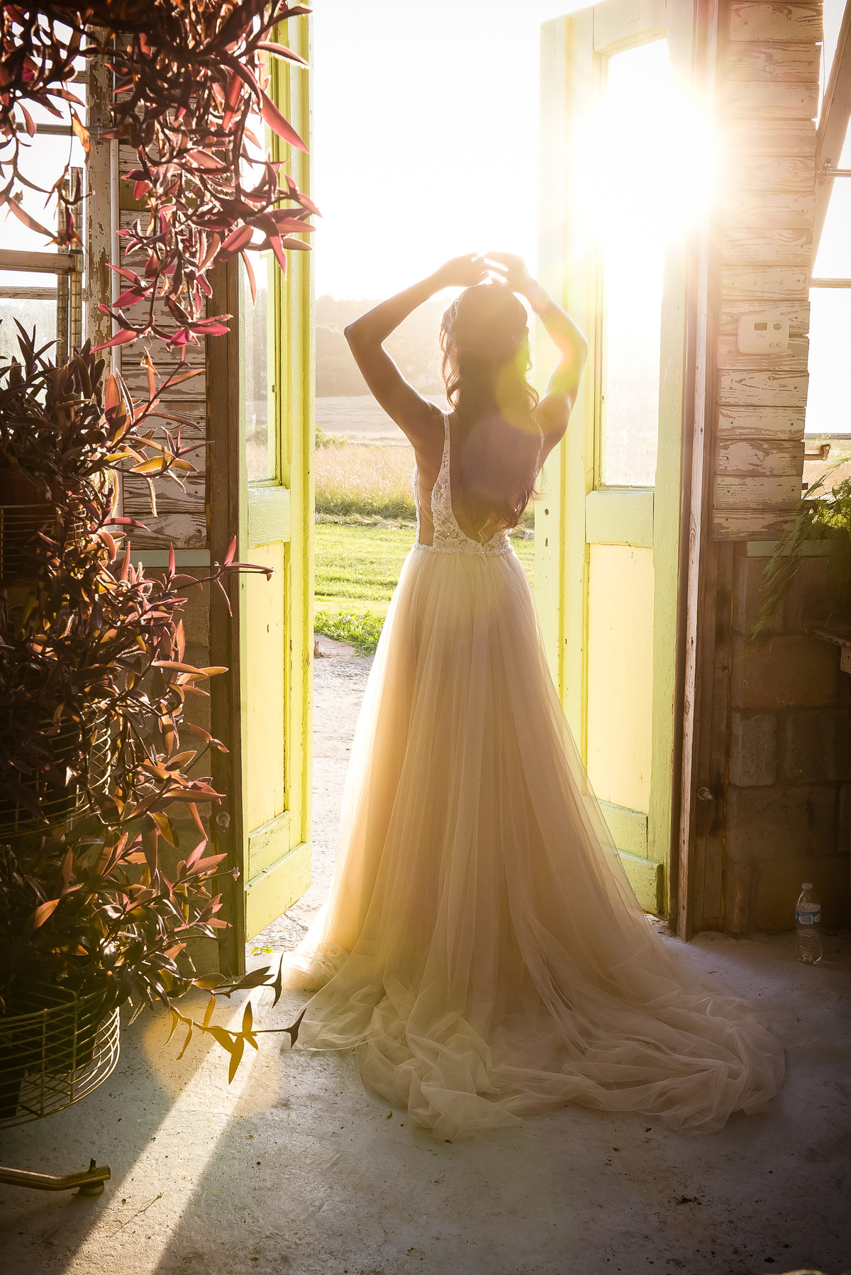 Bride in doorway at sunset