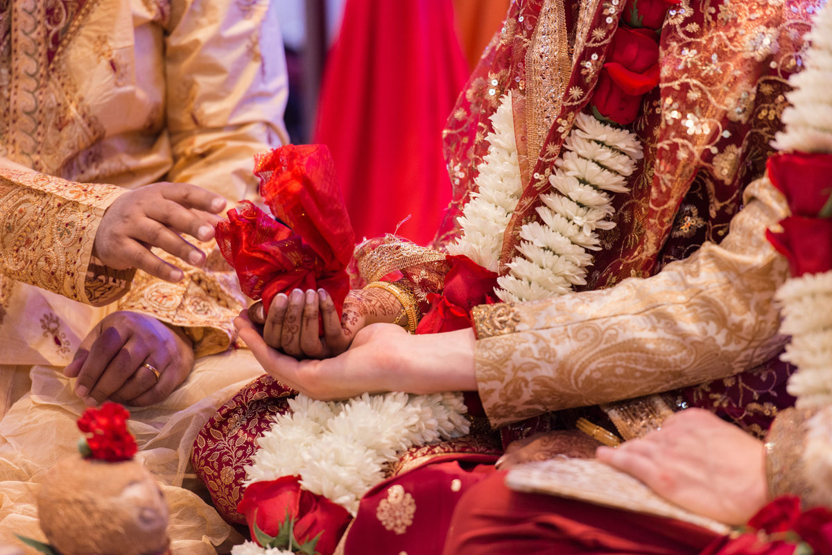 bride and groom performing traditional ceremony at Huntington Hilton