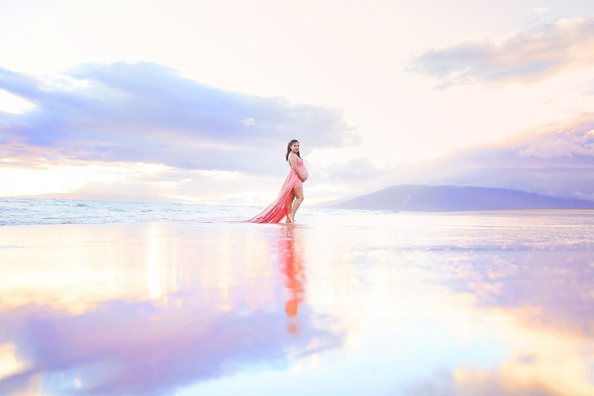 Maui maternity portraits featuring sand reflections at the beach during sunset portrait session