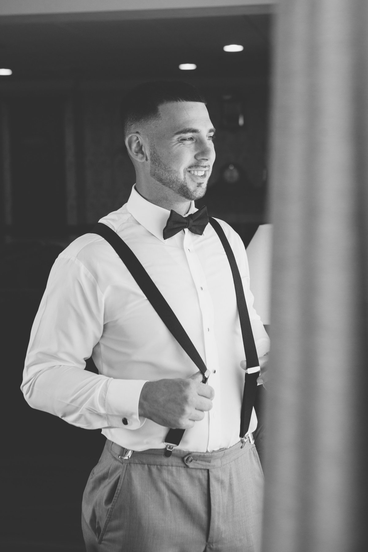 black and white photo of groom at Giorgios Baiting Hollow wedding