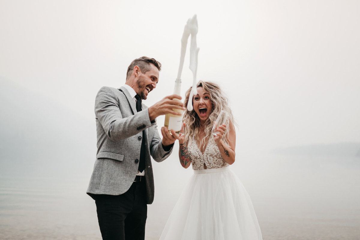athena-and-camron-sara-truvelle-bridal-wenatchee-elopement-intimate-35champagne-pop-bride-groom-fun