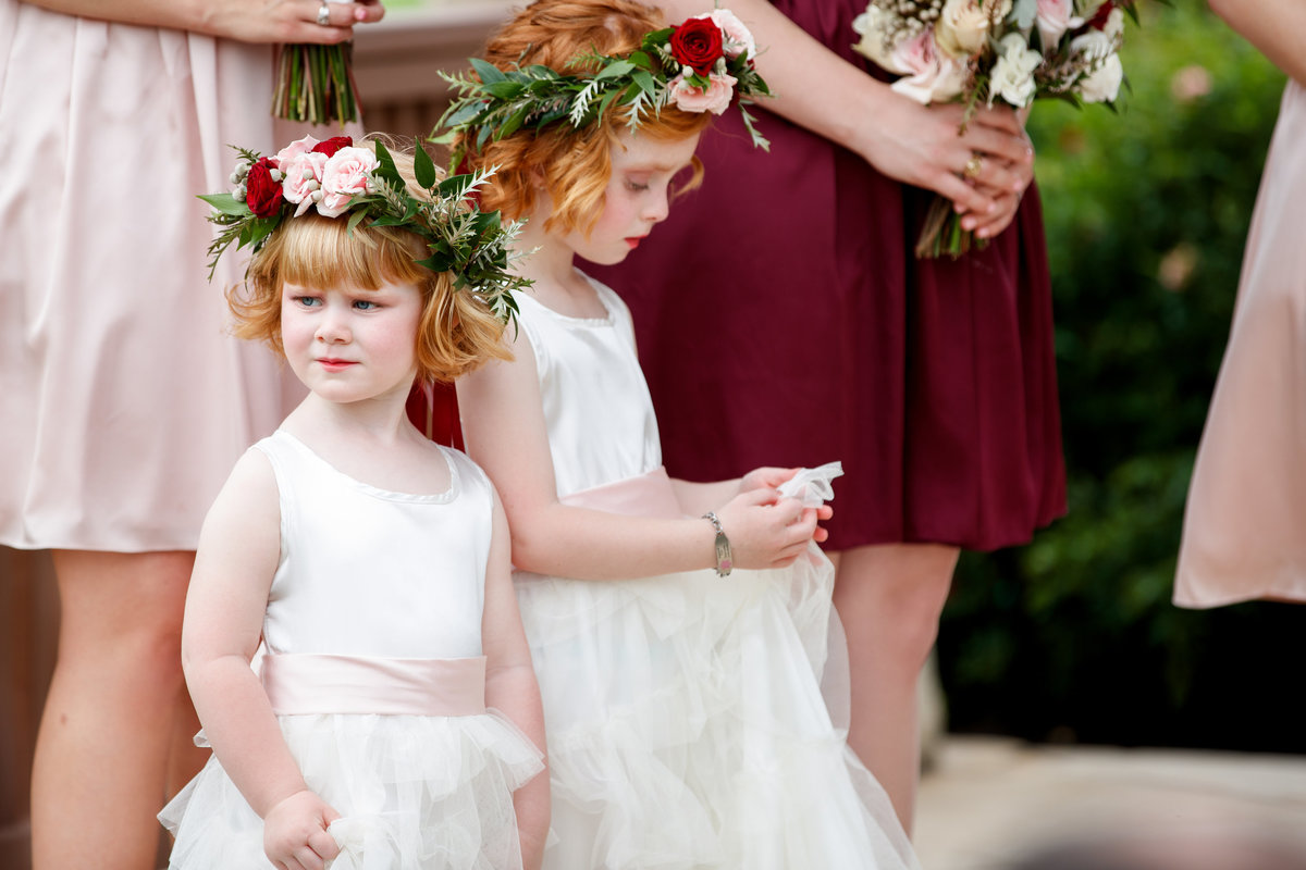 Camp Lucy wedding photographer flower girls 3509 Creek Rd, Dripping Springs, TX 78620