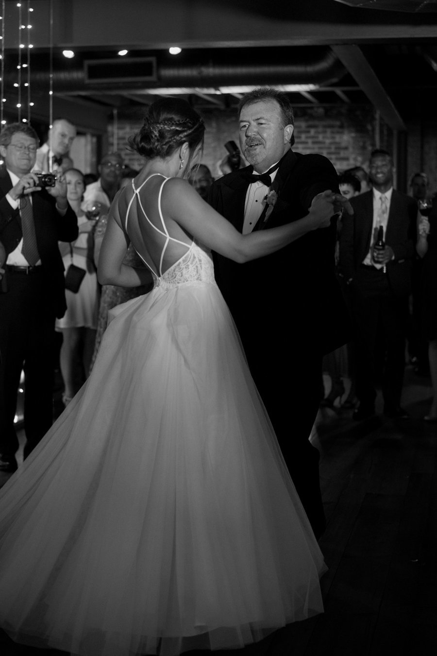 Bride dancing with father at Toolbox Yoga Studio Wedding near Dupont Circle,  Washington DC