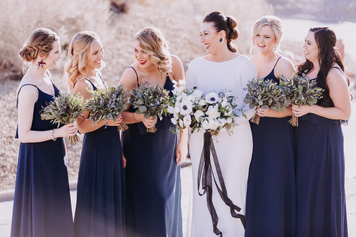 Lake Tahoe wedding photographers bride laughs with her bridesmaids