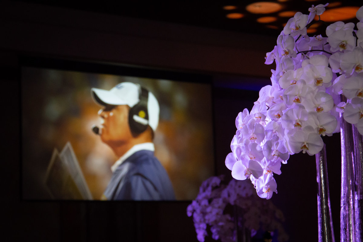 Coach Les Miles party white orchid centepiece