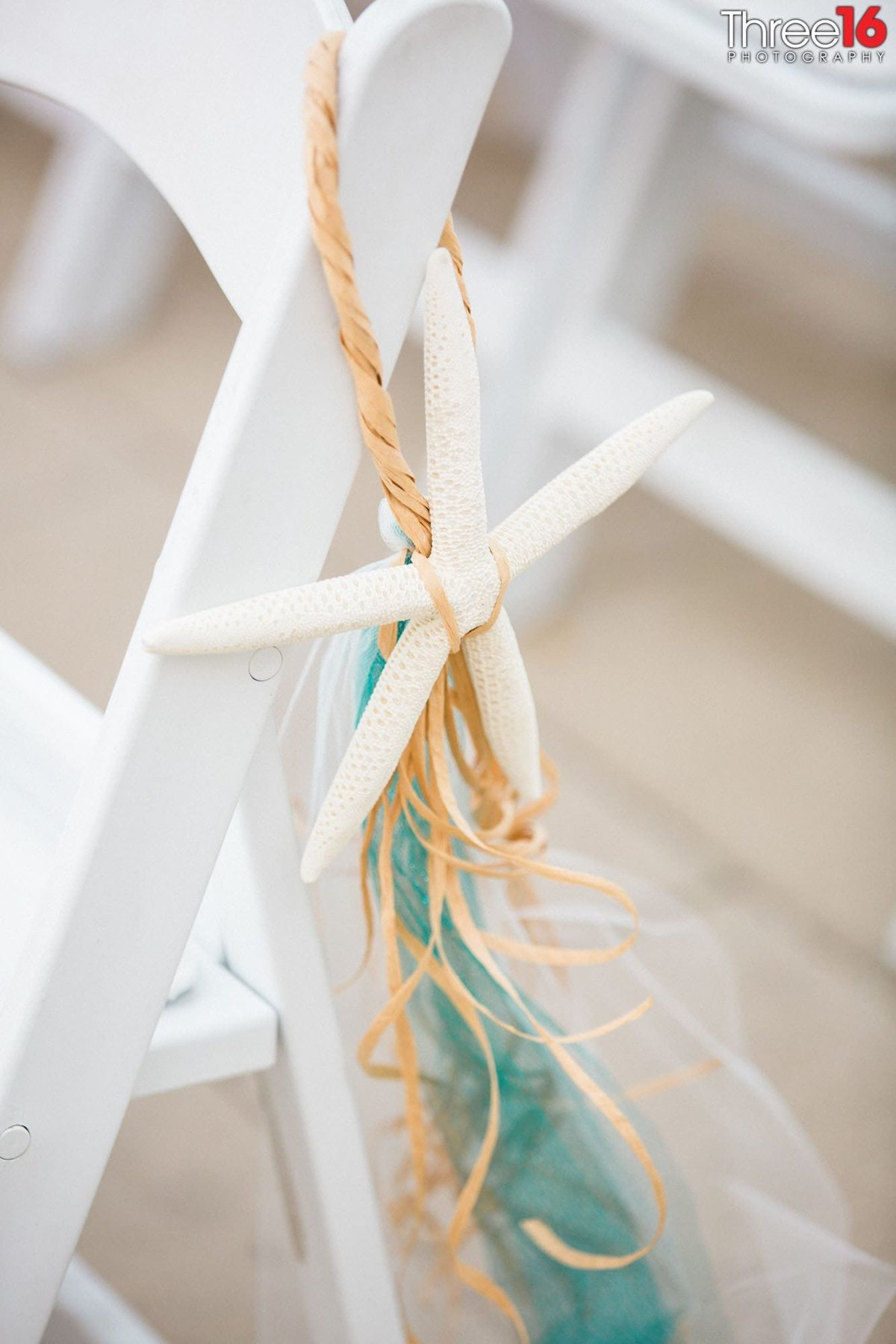 Beach themed decor on the chairs of a wedding ceremony at the Hotel Maya wedding venue