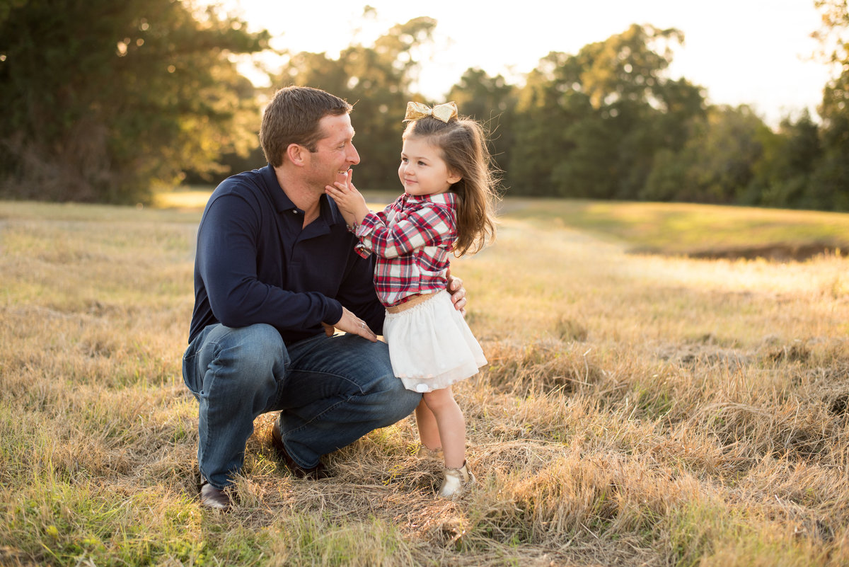 Daddy  & daughter during a sunset photoshoot in Spring, Tx