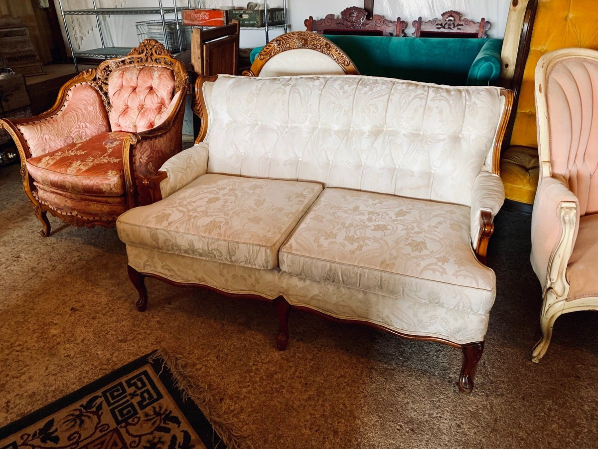 white antique loveseat