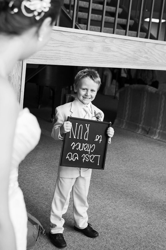 kid holding sign upside dow