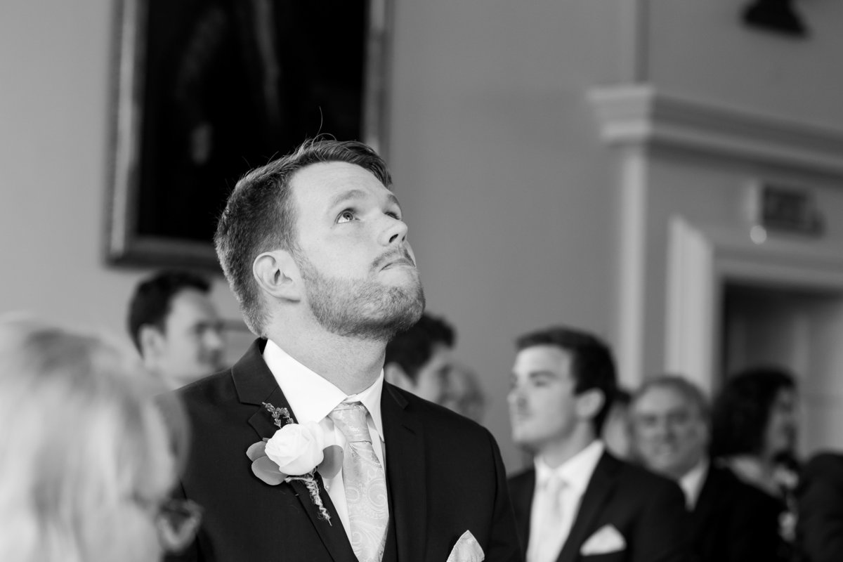 wedding photo of groom at wells town hall