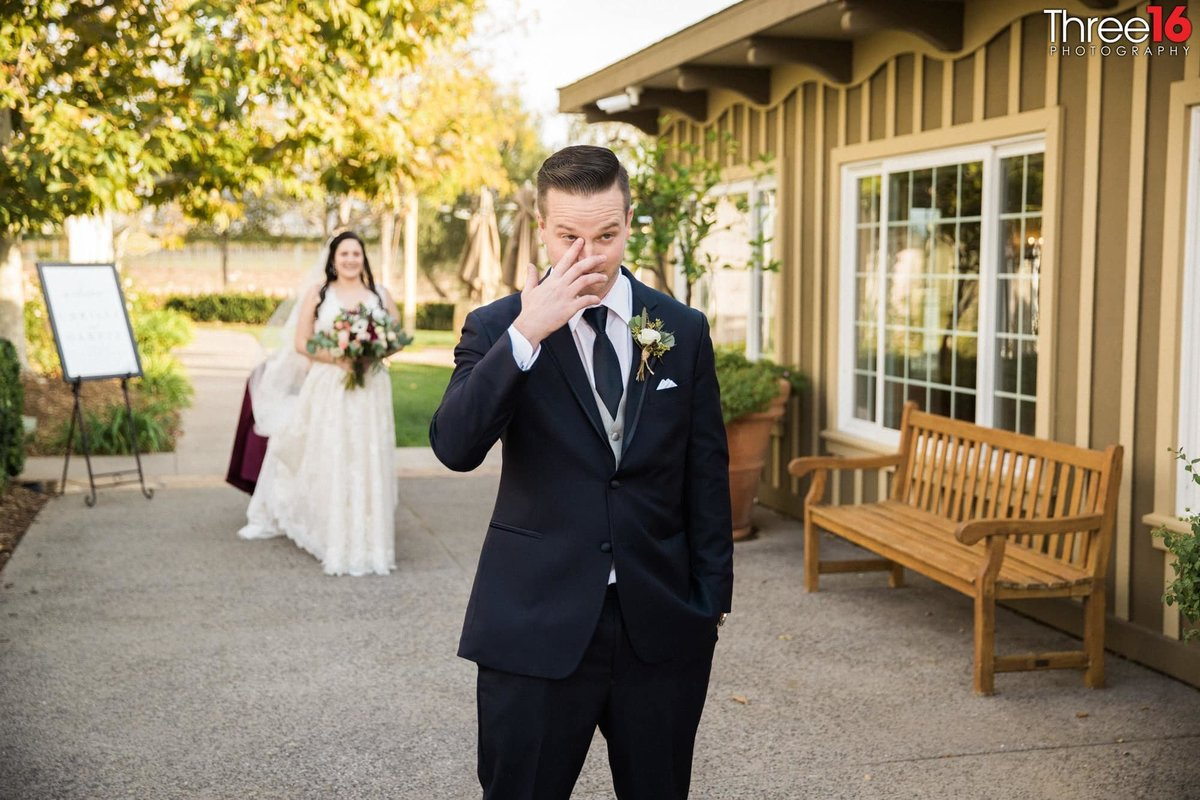 Teary-eyed Groom prior to his first look at his Bride in her wedding gown