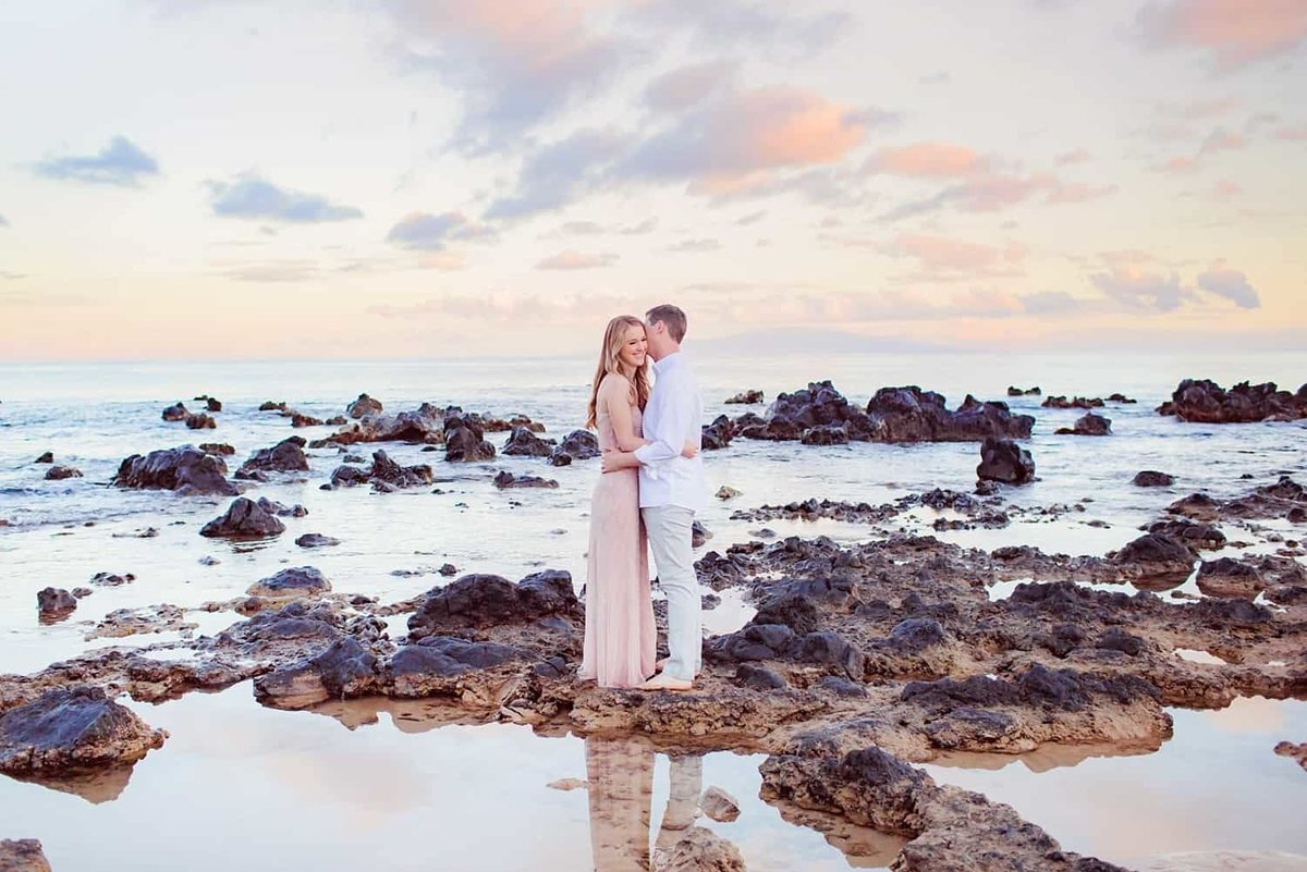 Couple kissing in a rock pool on Maui