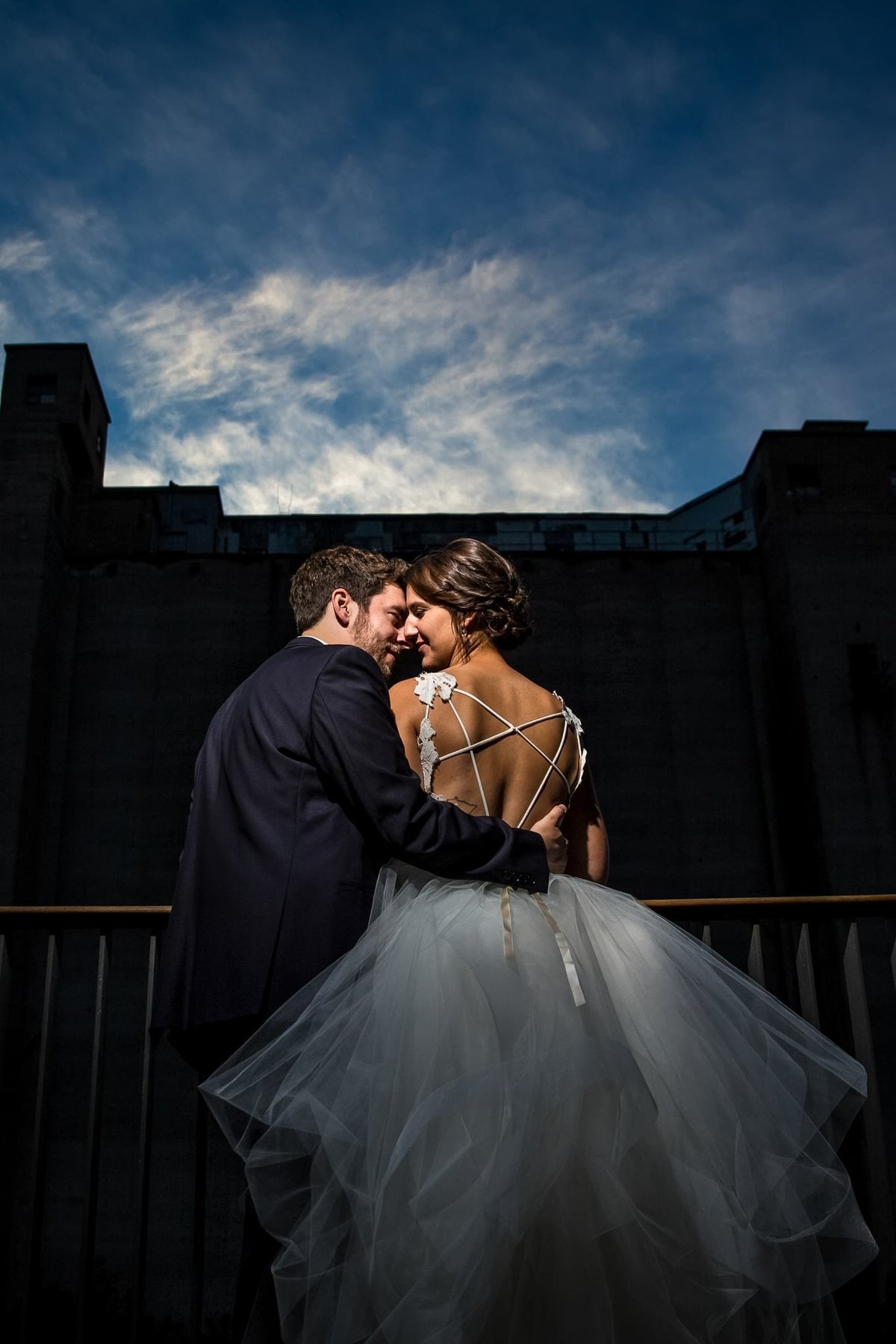 bride and groom having a moment during sunset at Surly brewery Minneapolis wedding photographer