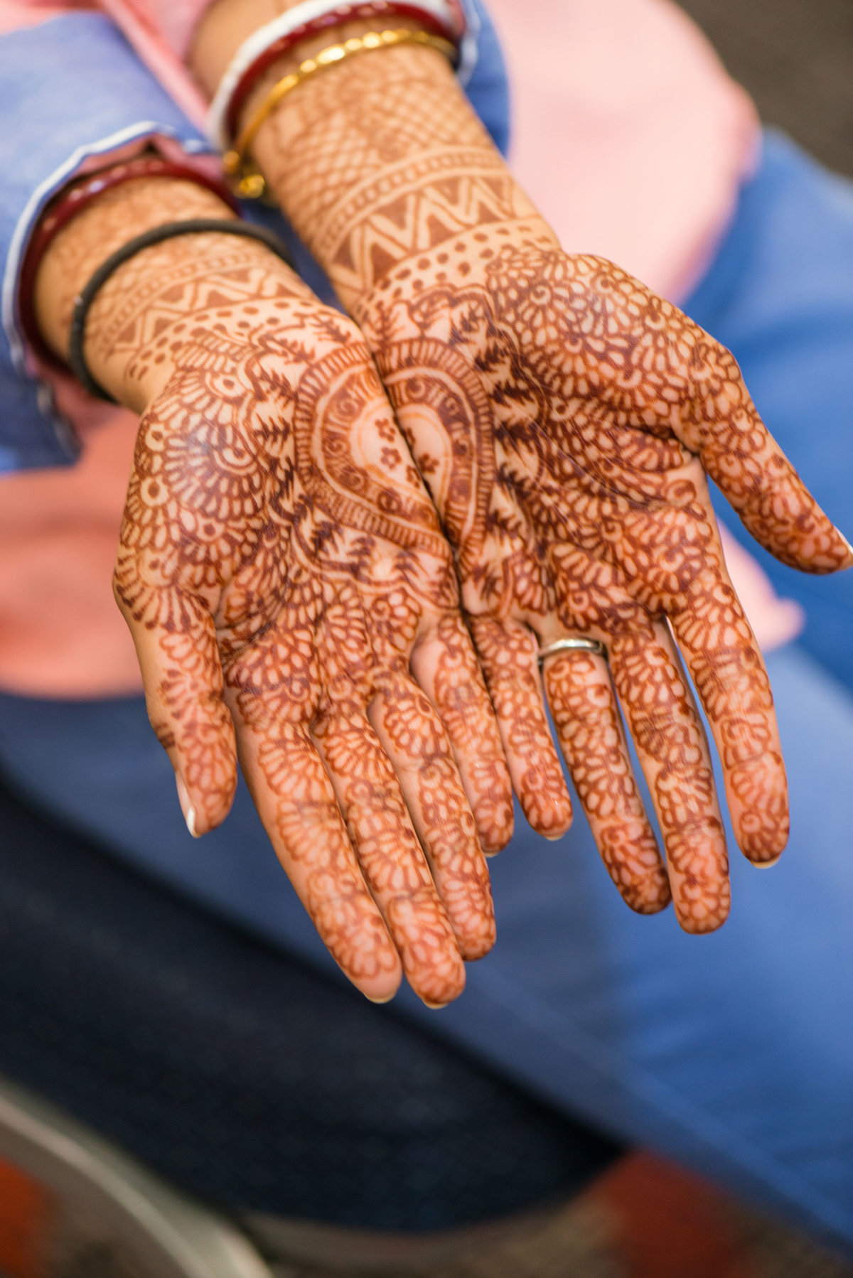 bride's hands covered with hennas at Huntington Hilton