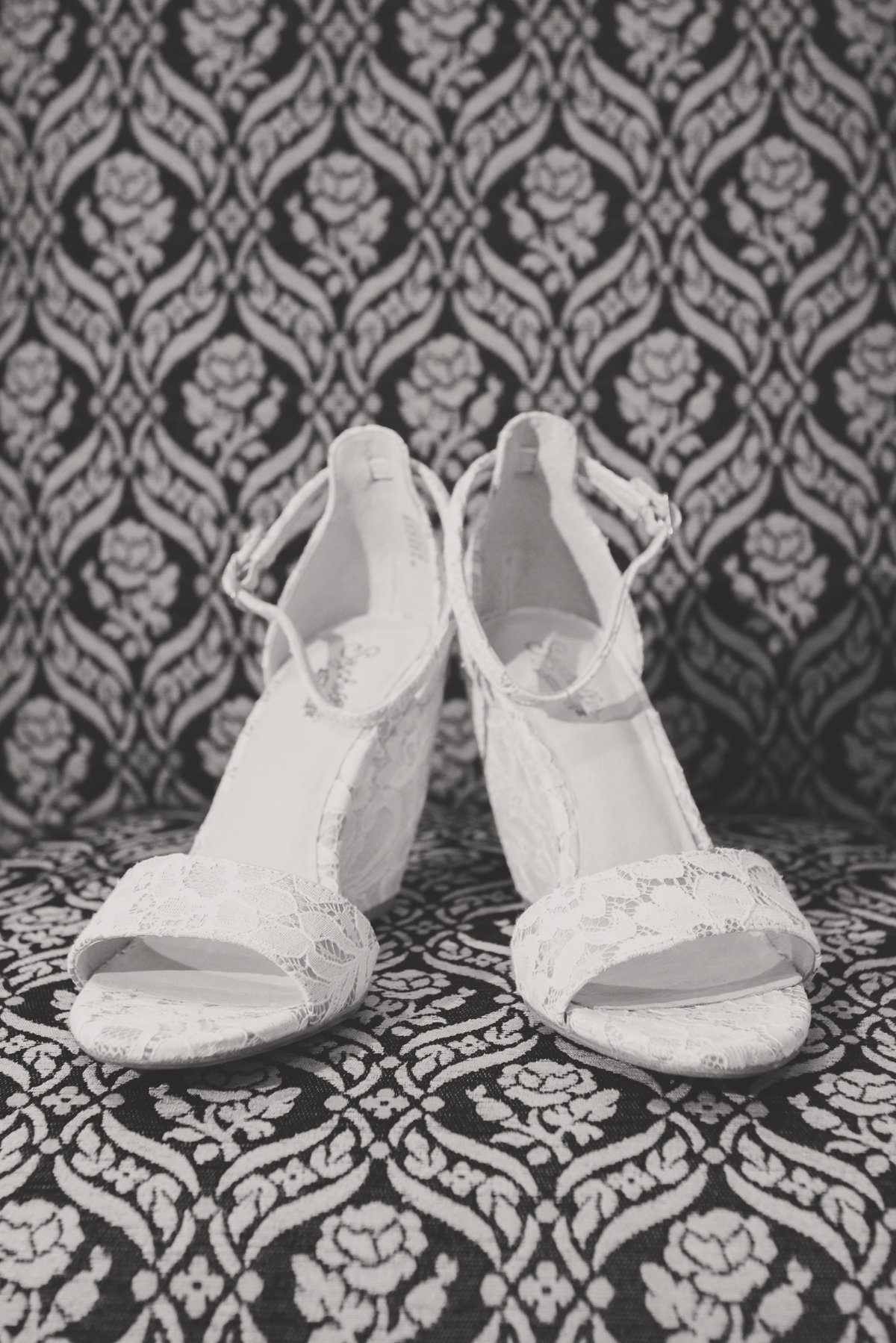 Bride's shoes at The Inn at Fox Hollow