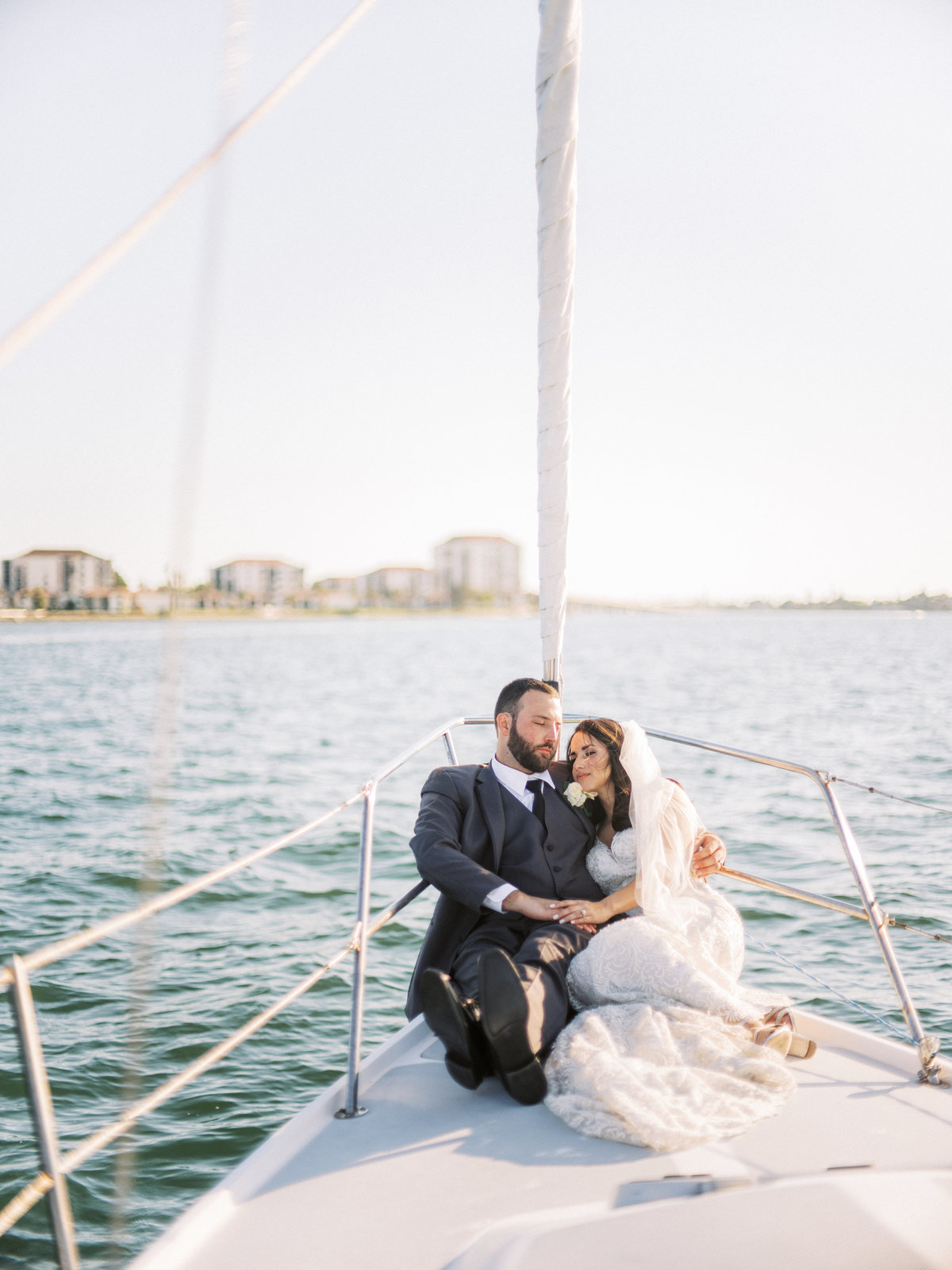 bride & groom on boat