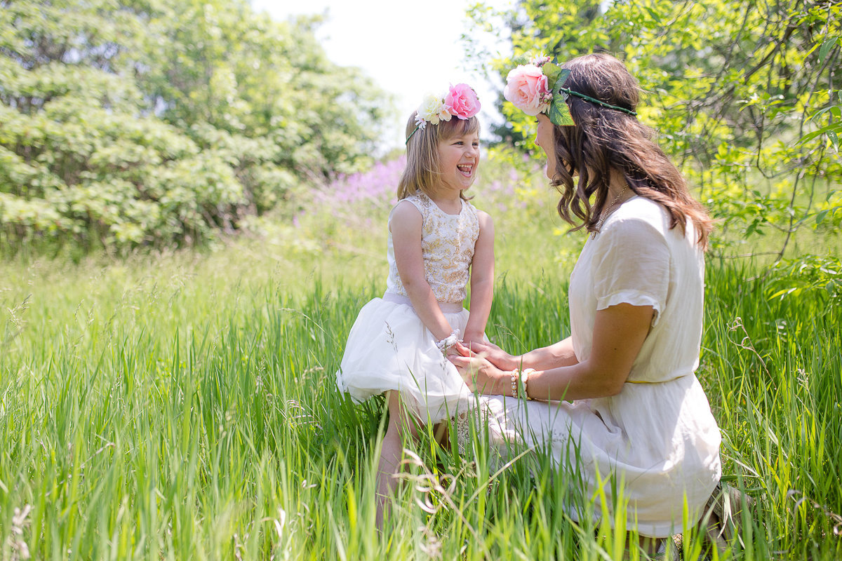 mother and daughter in floral crowns in field {Oakville Family Photographer}