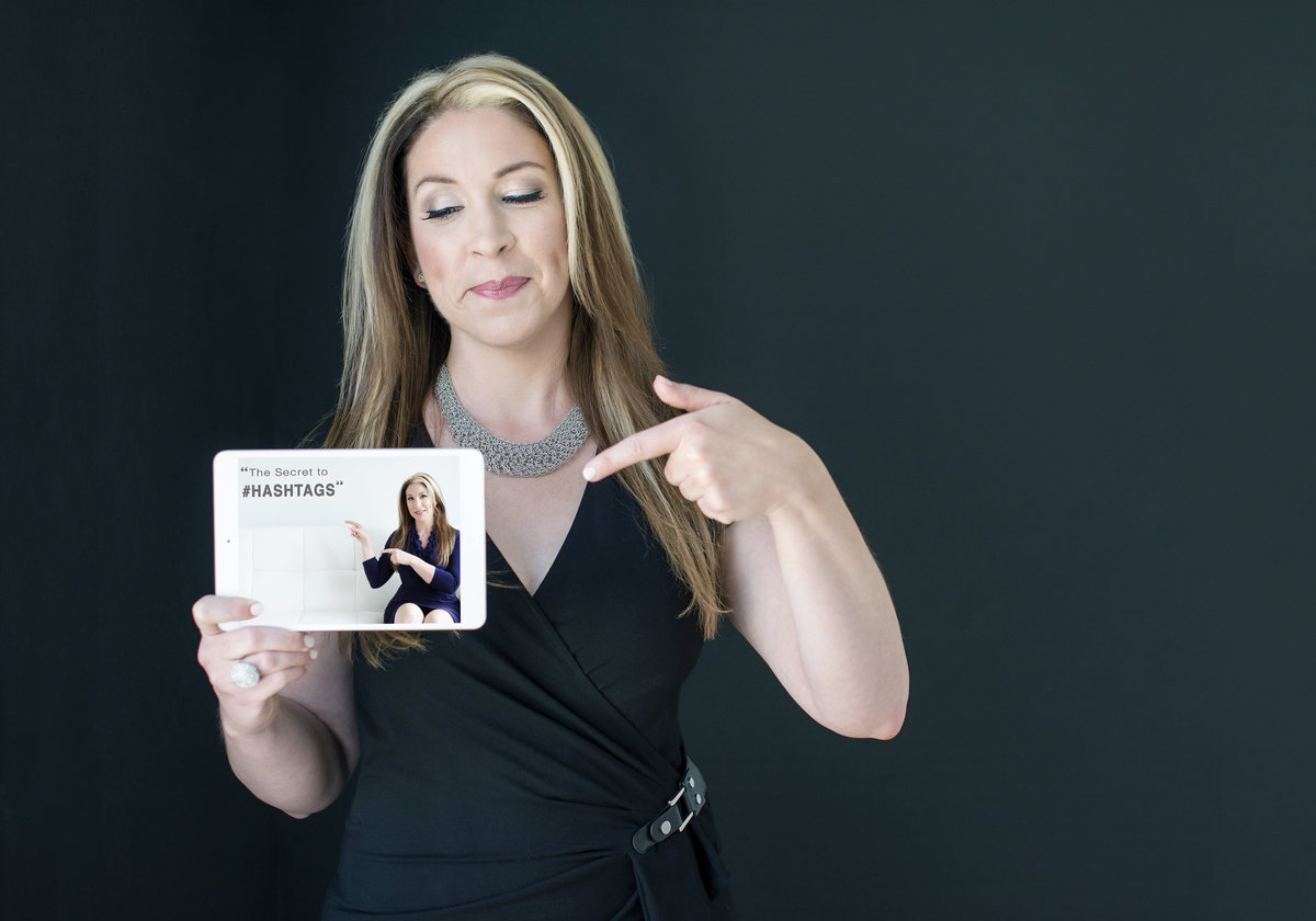 corporate  photography  portrait of  a leader holding a marketing card in hand