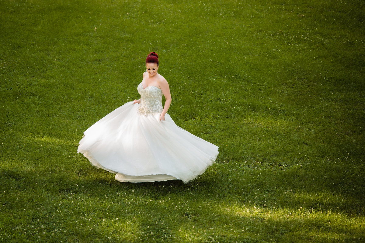 Black Hawk State Park wedding Bride twirling