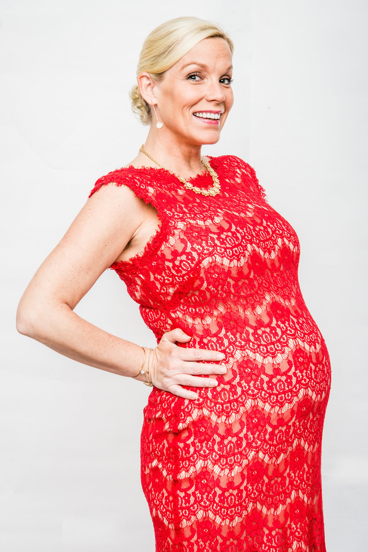 Pregnant woman in red lace dress
