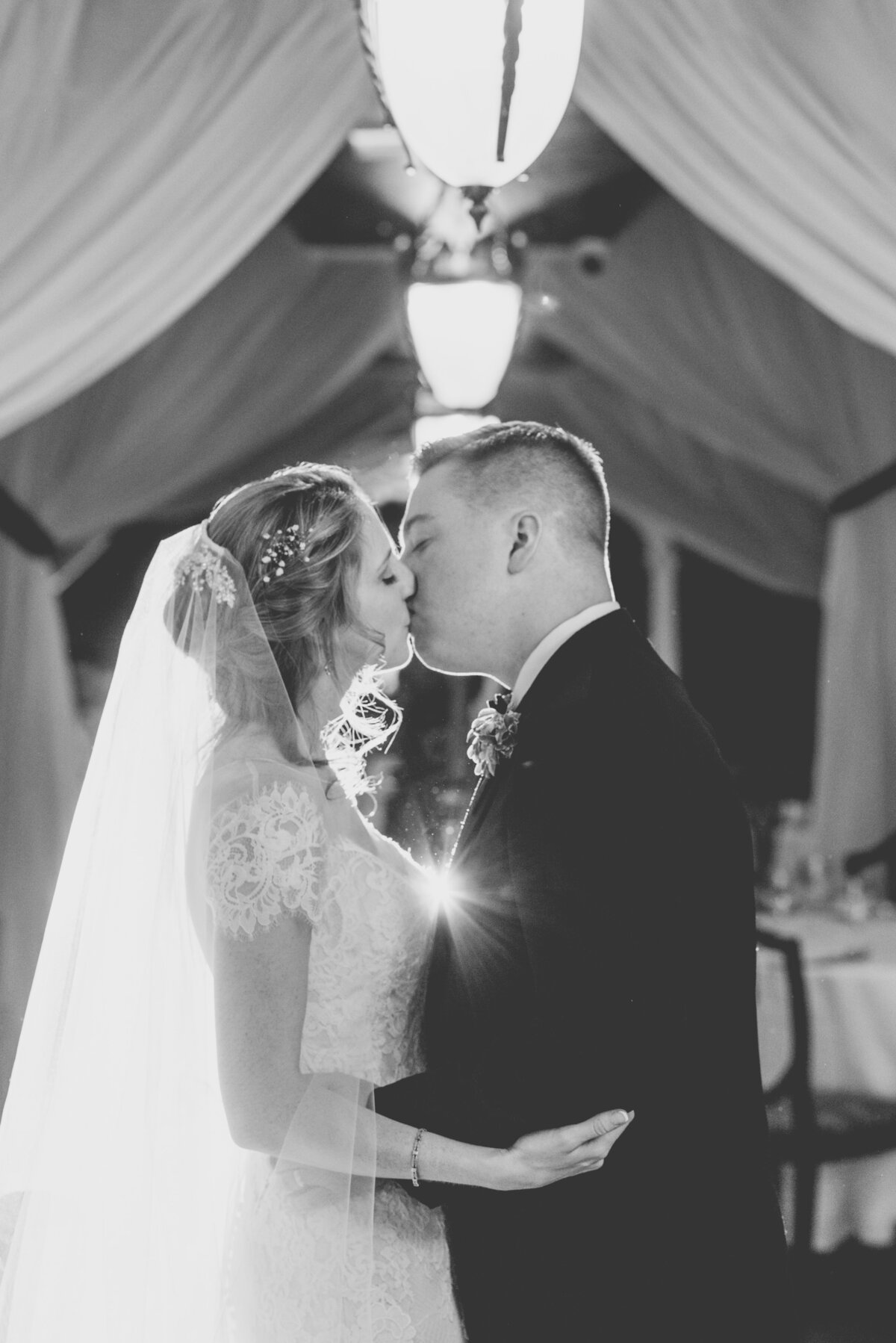 black and white wedding photo of bride and groom kissing at The Carltun